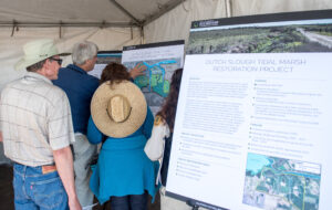 Attendees examine graphics on The Dutch Slough Tidal Restoration Project at the Groundbreaking of the project at a stretch of land just east of Oakley, California in Contra Costa County.<br /> The Department of Water Resources (DWR), along with state and local partners, today celebrated the groundbreaking of the Delta's largest tidal wetlands restoration project. The Dutch Slough Tidal Restoration Project will re-establish a rich ecological network that will boost survival rates of endangered fish and wildlife while also protecting neighborhoods against flooding, Photo taken October 17, 2018.<br /> Ken James / California Department of Water Resources, FOR EDITORIAL USE ONLY